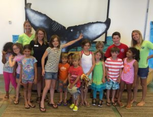 group photo with whale fluke