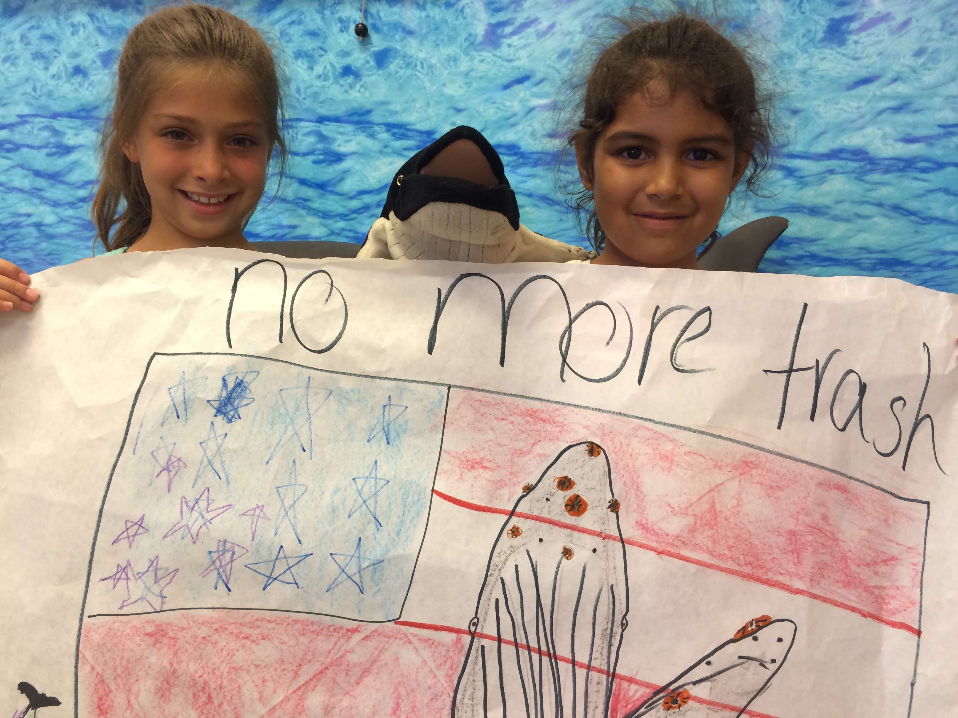 "Poster with USA flag, breaching whale and ""no more trash"""