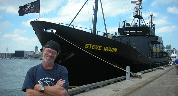 Peter Jay Brown, ocean activist, posing with the Sea Shepherd ship.